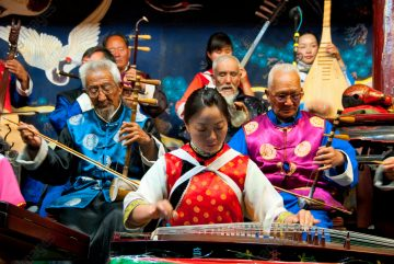 Naxi music is 500 years old, and with its mixture of literary lyrics, poetic topics, and musical styles from the Tang, Song, and Yuan dynasties, as well as some Tibetan influences, it has developed its own unique style and traits. There are three main styles: Baisha, Dongjing, and Huangjing, all using traditional Chinese instruments.  The Naxi or Nakhi are an ethnic group inhabiting the foothills of the Himalayas in the northwestern part of Yunnan Province, as well as the southwestern part of Sichuan Province in China. The Naxi are thought to have come originally from Tibet and, until recently, maintained overland trading links with Lhasa and India.  The Naxi form one of the 56 ethnic groups officially recognized by the People's Republic of China. The Naxi are traditionally followers of the Dongba religion. Through both Han Chinese and Tibetan cultural influences, they adopted Tibetan Buddhism and, to a lesser extent, Taoism, in the 10th century.